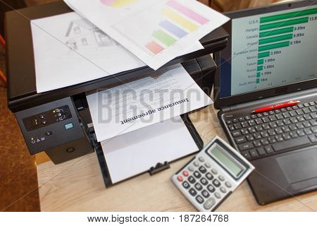 Homeowner and car Insurance form with Laptop Printer pen calculator on the table. Insurance concept