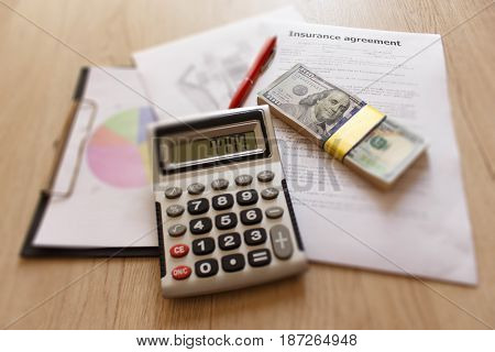 Insurance form with pen dollars calculator on the table. Insurance concept. Homeowner insurance policy
