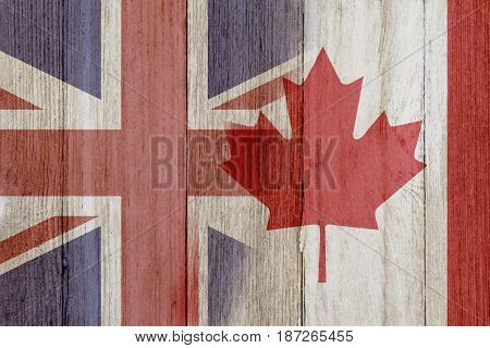Relationship between the Britain and Canada The flags of Britain and Canada merged on weathered wood 3D Illustration