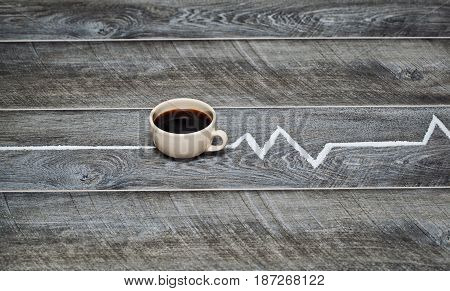 invigorating coffee and cardiogram on a wooden table vintage
