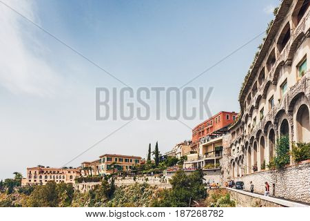 TAORMINA, SICILY, ITALY - Circa April, 2017: View across the town of Taormina, Sicily with its historic architecture perched on a high hilltop overlooking the Bay of Giardini Naxos