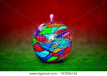 decorative apple, made of wood and painted by hand paints. modern creative handmade