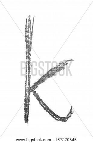 Single hand drawn with the chalk K letter isolated over the white background