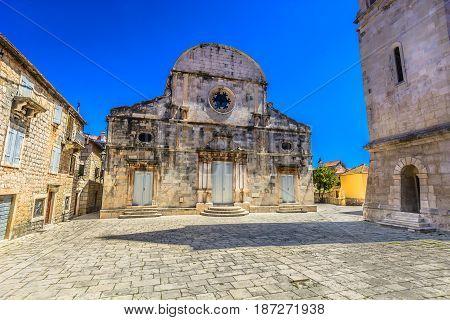Old parish stone church in city center of town Starigrad, Island Hvar, european summertime travel places.