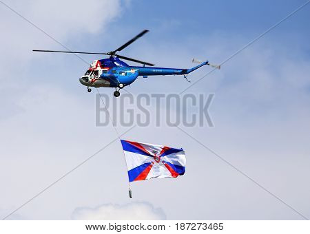 MOSCOW REGION - JULY 27: Military transport helicopter  with the flag of the Russian Federation at the opening of the military holiday    on July 27, 2016 in Moscow region