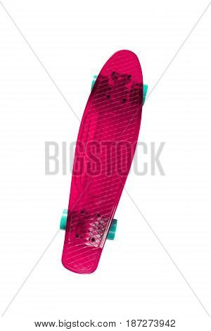 Magenta skateboard isolated on a white background