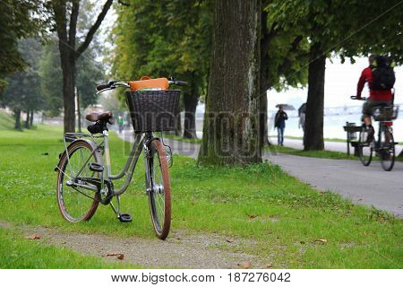 Travel To Salzburg, Austria. A Bicycle On A View Of A Park, A River And Mountains.