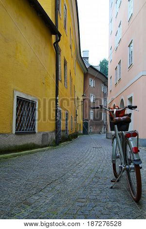 Travel To Salzburg, Austria. A Bicycle On The Narrow Street In The City Center.