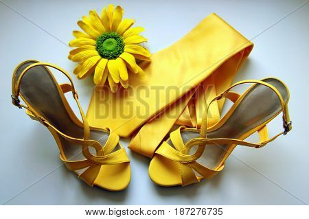 Yellow Sandals, Tie And Flower For Wedding On The White Background.