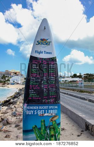 MAHO BAY BEACH  AUGUST 01: Maho Bay Beach view with Fligh Times board from Sunset Bar and Grill seen in St.Martin/St.Maarten on August 1, 2015