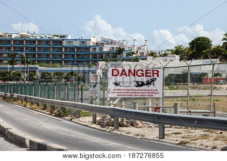 MAHO BAY BEACH  AUGUST 01: Airoport  sign on Princess Juliana International Airport fence near Maho Bay Beach seen in St.Martin/St.Maarten on August 1, 2015