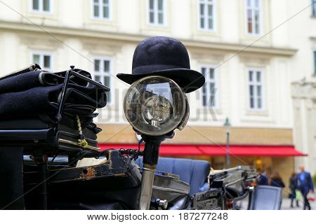 Travel To Vienna, Austria. The Black Hat On A Spotlight Of A Carriage.