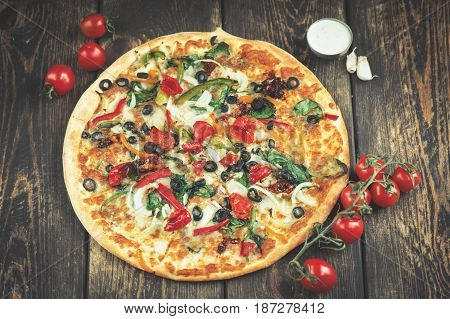 Delicious fresh pizza served on wooden table background