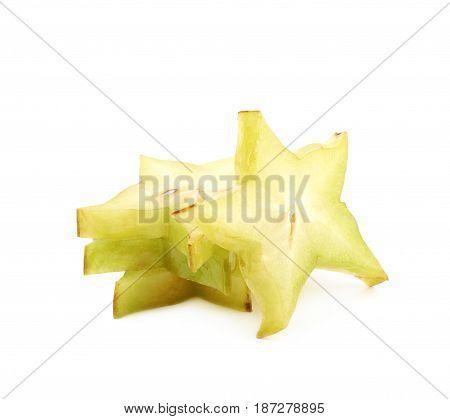 Pile of sliced carambola starfruit fruits isolated over the white background