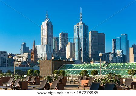 Langham Hotel Sun Deck With Melbourne Cbd View On Background