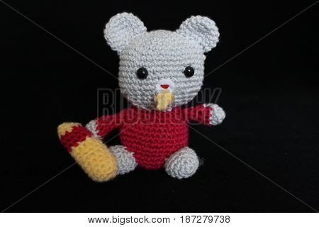Woolen toy made in crochet and hand on black background
