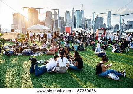 NEW YORK - MAY 19 2017: People realaxing and having fun on the outdoors event in New York City at summer