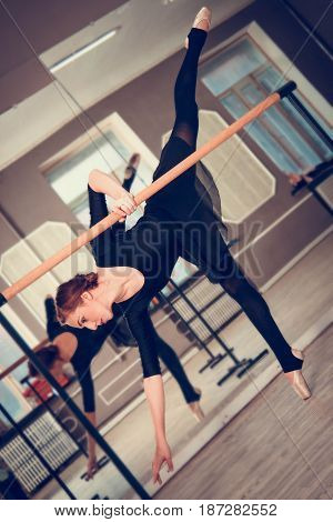 Young Beautiful Graceful Ballerina Dances In Ballet Class On Pointes