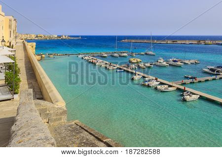 Salento coast: panorama of the port of Otranto.Italy(Apulia).View from the old town surrounded by crystal clear sea. poster