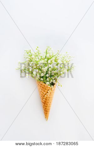 Beautiful Bouquet Of Lilies Of The Valley,may-lily Flowers In A Waffle Corn On The White Background,