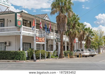 MIDDELBURG SOUTH AFRICA - MARCH 21 2017: A street scene in Middelburg in the Eastern Cape Karoo Region. A hotel and restaurant are visible