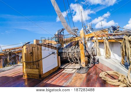 The ship's bell and the anchor lift mechanism on the sailboat
