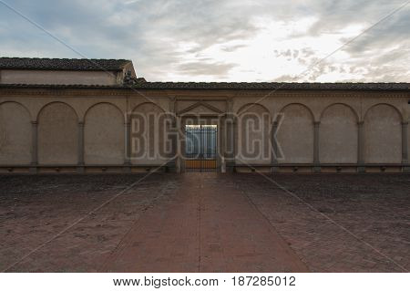 Italy Florence - December 24 2016: the view of the entrance of Florence Charterhouse church Certosa di Galluzzo di Firenze. View from inner courtyard on December 24 2016 in Florence Tuscany Italy.
