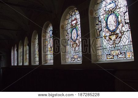 Italy Florence - December 24 2016: the view of the stained glass with scenes from the life of Saint Benedict in the colloquium corridor inside Florence Charterhouse church. Certosa di Galluzzo di Firenze on December 24 2016 in Florence Tuscany Italy.