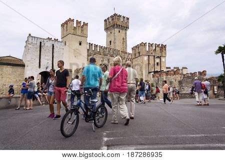 Sirmione, Italy - July 31: People Walking In Front Of Scaliger Castle On 31 July 2016 In Sirmione, I