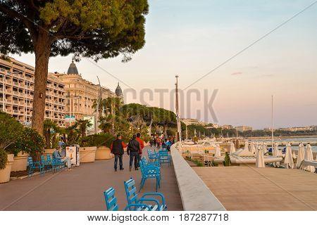 Tourists Walk Along Famous Promenade De La Croisette