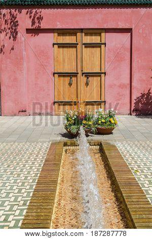 old wooden door in a arabic garden with fountain