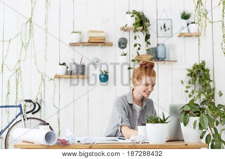 Cheerful Positive Young Redhead Woman Designer With Hair Bun Making 3D Interior Design Using Cad Sys