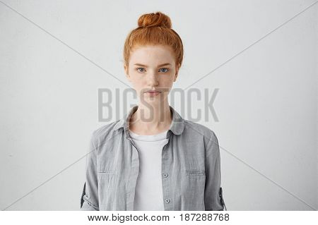 Waist Up Portrait Of Beautiful European 20 Y.o. Woman With Freckles And Hair Knot Posing Isolated Ag