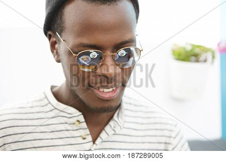 Close Up Portrait Of Positive Happy Young African American Man Wearing Trendy Sunglasses And Hat Smi