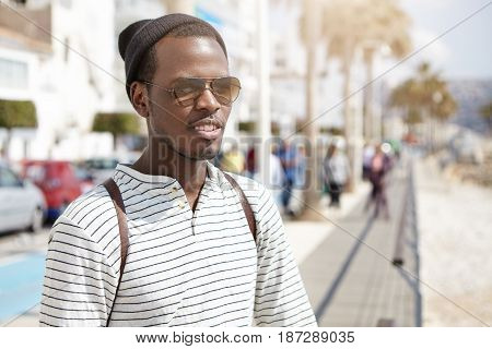 Summer, Travel And Vacations Concept. Handsome Fashionable Young Dark-skinned Man In Stylish Wear Ha