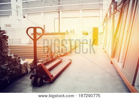 Building materials warehouse, logistics concept, construction of houses, loader. high contrast and monochrome color tone.