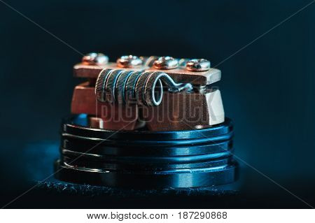 Winding close-up for electronic cigarettes from nichrome, fecral. vape. Staggerton Fused Clapton Coil on Dripper for vaping.