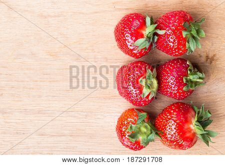 Red Fresh Strawberry Fruits On Wooden Table.