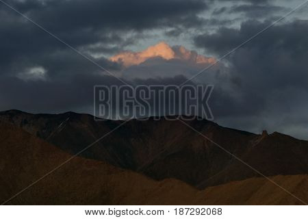 Sunset In The Mountains: The Silhouettes Of The Chain Of Hills Are Immersed In Twilight, Dark Blue S
