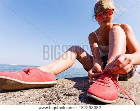 Young Girl Tying Shoelace.