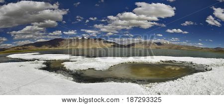 Shores Of Tso Kara Lake, Covered With Snow-white Crust Rock Salt, In Which Individual Puddles Salt W