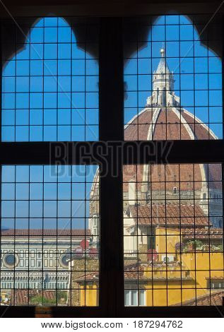 Dome of the Cathedral (Duomo) as seen through a window of the Old Palace (Palazzo Vecchio) - Florence Tuscany Italy