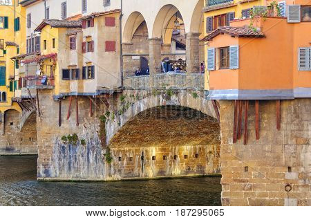 Colourful shops on the Ponte Vecchio above the Arno river - Florence Tuscany Italy, 14 October 2011