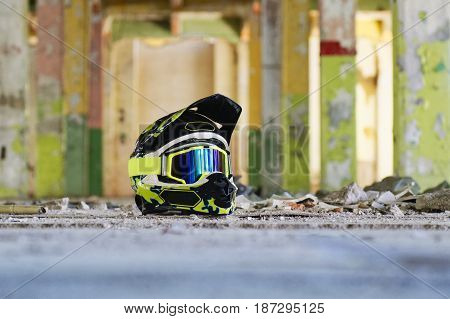 Motocross helmet on the floor in a old hall