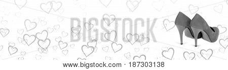 Black and white horizontal banner. Hearts background with a pair of woman shoes. Woman's high heels. Grey stilettos. The background has hearts