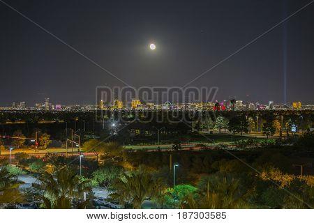 Las Vegas, Nevada, USA - May 13, 2017:  Night view of Las Vegas strip resort towers with moon.