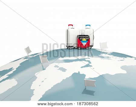 Luggage With Flag Of Antigua And Barbuda. Three Bags On Top Of Globe