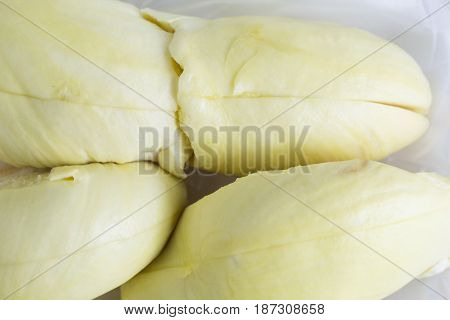 Durian in Thailand sweet fruit in the white background. Close up of peeled durian. Close up of peeled durian flesh isolated on white background.