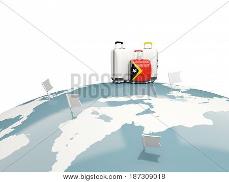 Luggage With Flag Of East Timor. Three Bags On Top Of Globe