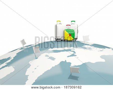 Luggage With Flag Of French Guiana. Three Bags On Top Of Globe